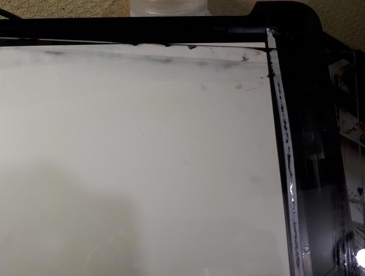 залитый чернилами сканер